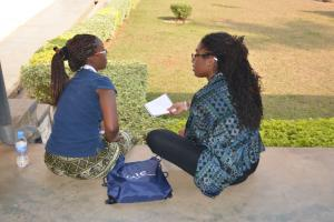 Ampofo consults a YYAS student.