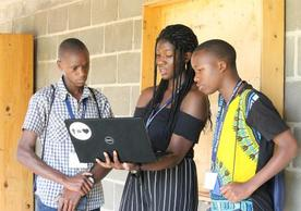 Yale student instructor Elizabeth Olatunji (YC '20) shows YYAS students how to access online university applications. Photo credit Dagan Rossini.